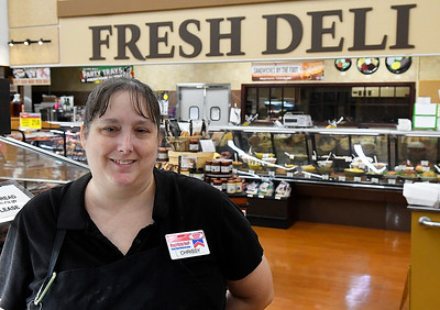 Jumbo West employee, Chrissy Bell, stand near the deli section following an interview August 6, 2019. Bell performed CPR on a fellow employee after he collapsed with a heart attack and she is credited with saving his live. (Billy Hefton / Enid News & Eagle)