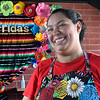 Maria Aguirre laughs during an interview at Frida's Cravings Tuesday, August 4, 2020. (Billy Hefton / Enid News & Eagle)