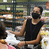 Serena Delgadillo (right) helps a client with shopping at Loaves & Fishes Monday, August 2, 2021. Loaves & Fishes food pantry has reopened to allow client shopping. (Billy Hefton / Enid News & Eagle)