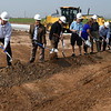 Officials turn a shovel full of dirt during a groundbreaking ceremony for the Advance Soccer Complex Tuesday, August 3, 2021. (Billy Hefton / Enid News & Eagle)
