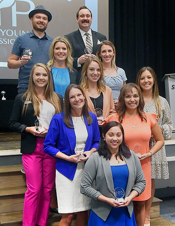 Enid Young professionals named their 10 < 40 winners during a lucheon Tuesday, August 31, 2021. (Front) Charlet Ringwald, (Second Row) Jessica Nelson and Nicole Winfield, (Third Row) Anderson Hubbard, Jenny Ahrens and Ashley Hendricks, (Fourth Row) Rachel Snider and Ryan Zaloudak, (Back Row) Justin Blasier and Kegan Touhy. (Billy Hefton / Enid News & Eagle)