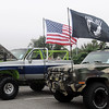 American flags and a POW-MIA flag greet guests at the American Garfieldi Car and Motorcycle show Saturday at Meadowlake Park North. Proceeds from the event support the Vietnam Memorial Wall project. (Staff Photo by BONNIE VCULEK)