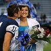 "Enid High School football homecoming king Seth ""Popeye"" Handley gives queen Raquel Estrada a traditional kiss on the cheek during festivities Friday at D. Bruce Selby Stadium. (Staff Photo by BONNIE VCULEK)"