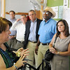 NORCE executive director, Sally Randall, talks a group of state officials on a tour of the facility campus Tuesday. (Staff Photo by BILLY HEFTON)