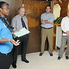Dr. Willie Pitts (left) talks to a group of state officials taking a tour of the NORCE facility Tuesday. (Staff Photo by BILLY HEFTON)