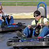 Merrill Eck takes the lead over his brother, Darrell, as they round a sharp curve at Comet Go Carts Sunday. The duo live in Oregon and are visiting family and friends in Enid. (Staff Photo by BONNIE VCULEK)