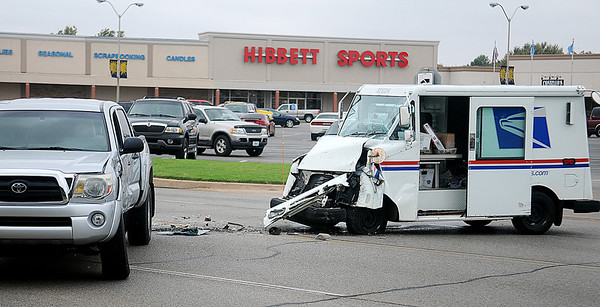 An Enid postman collided with the driver of a Toyota Tundra truck Saturday near Sunset Plaza. (Staff Photo by BONNIE VCULEK)