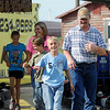 Brooklyn Owens, Carol Jackson, Christopher Eck, Kean Eck and Darrell Eck (from left) head to the Comet Go Carts' ticket booth for more riding fun Sunday. The family and friends spent the afternoon and evening bumper to bumper on the track and then in the stands at the Enid Speedway. (Staff Photo by BONNIE VCULEK)