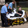 Emergency personnel tend to a stabbing victim Monday on east Cherokee. (Staff Photo by BILLY HEFTON)