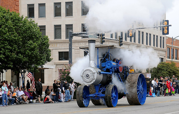 """H.E. Cummins """"The Baker"""" steam-powered engine rolls west on Randolph during the Cherokee Strip Celebration parade Saturday. (Staff Photo by BONNIE VCULEK)"""