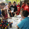 Children and their parents claim their deeds after staking their land during Leonardo's Family Fun Festival at Adventure Quest Sunday. (Staff Photo by BONNIE VCULEK)