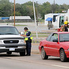 Enid Police Officer Justin Lamle investigates a 3-car crash on the N. Van Buren overpass as Enid Fire Fighters assist at the scene. Life EMS transported ??????????????? to a local hospital. (Staff Photo by BONNIE VCULEK)