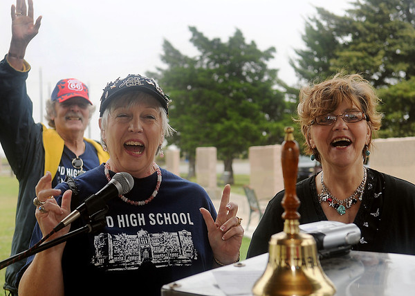 Cheryl Duffy Scott (front, left), who organized the EHS class of 1965 reunion, tells her former classmates that they have extra funds in their reunion account. The class chose to donate the money to the Traveling Vietnam Wall Project. (Staff Photo by BONNIE VCULEK)