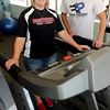 Iron Works' Kelly Reyes (left) and Finer Physiques' Travis Morgan pause inside Finer Physics Express location at 101 West Randolph Wednesday. The business is the third exercise facility for the two sister companies. (Staff Photo by BONNIE VCULEK)