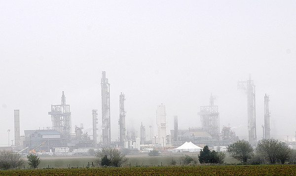 Fog obscures the view of the KOCH plant east of Enid early Saturday morning. (Staff Photo by BONNIE VCULEK)