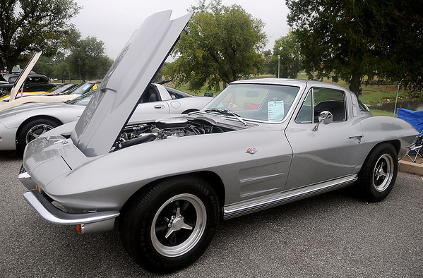 Jean Hendricks, from Oxford, Kan., displays her 1964 Chevy Corvette Sting Ray Saturday during the American Garfieldi Car and Motorcycle Show at Meadowlake Park North. Proceeds from the event support the Vietnam Memorial Wall project. (Staff Photo by BONNIE VCULEK)