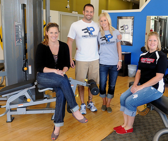 Megan Liebl, Travis and Kristen Morgan and Kelly Reyes (from left) pause inside Finer Physiques Express Wednesday at The Chiropractic Center, 101 West Randolph. The downtown center features free tanning, pilates, cardio, strength, nutrition and personal training Monday, Tuesday, Wednesday and Friday from 8:30 a.m. - 6 p.m., Thursday from 10 a.m. - 7 p.m. and Saturday from 10 a.m. - 5 p.m. (Staff Photo by BONNIE VCULEK)