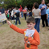 Billy Combs holds his family land run stake and deed after the Leonardo's Family Fun Festival land run Sunday at Adventure Quest. The event was part of the Cherokee Strip Celebration festivities in Enid. (Staff Photo by BONNIE VCULEK)