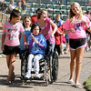 Jensyn (center) and her friends lead the 2012 4RKids Walk/Run Saturday at David Allen Memorial Ballpark. (Staff Photo by BONNIE VCULEK)