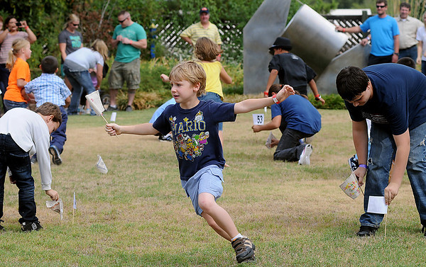 Children stake their claims at Adventure Quest during Leonardo's Family Fun Festival Sunday. All activities at Leonardo's Discovery Warehouse and Adventure Quest were free to the public as part of the Cherokee Strip Celebration festivities. (Staff Photo by BONNIE VCULEK)