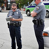 Enid police training officer, Casey Von Schriltz,  watches as rookie officer Tom Rhyne fills out an accident report September 24 in downtown Enid. (Staff Photo by BILLY HEFTON)