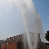A geyser of water erupts from a broken water main Friday in front of Living Word Church, 905 W. Rush. (Staff Photo by BONNIE VCULEK)