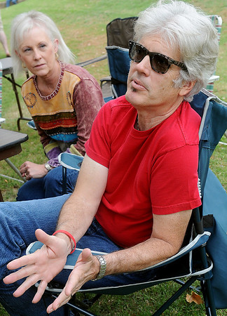 Wes and Jolene Gray explain their passion for photographing and recording local musicians during Fling at the Springs Saturday at Government Springs Park. (Staff Photo by BONNIE VCULEK)