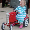 Olivia Brush enjoys her tractor ride at Enid Farmers Market Saturday. (Staff Photo by BONNIE VCULEK)
