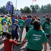 4RKids Walk/Run teams trek around the warning track at David Allen Memorial Ballpark. The annual event raised more than $61,000 for the 4RKids Foundation projects for developmentally disabled and special needs children and adults. (Staff Photo by BONNIE VCULEK)