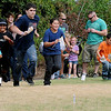 Children sprint across the lawn to stake their claim at Adventure Quest during Leonardo's Family Fun Festival Sunday. All activities at Leonardo's Discovery Warehouse and Adventure Quest were free to the public as part of the Cherokee Strip Celebration festivities. (Staff Photo by BONNIE VCULEK)