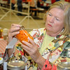 Kaye Tipton judges a jar of canned vegetables Thursday at the Garfield County Fair. (Staff Photo by BILLY HEFTON)