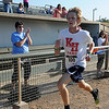 Garrett Wallace wins the 4RKids 5K Run men's division with a personal best time of 19:12 Saturday at David Allen Memorial Ballpark. Lydia Willemse-Brett finished in 17:47 to win the women's overall award during the 2012 4RKids Walk/Run. (Staff Photo by BONNIE VCULEK)