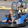 With her NASCAR face on, Brooklyn Owens (front) maintains her early lead on Merrill and Kean Eck Sunday at Comet Go Carts, 3200 N. 4th. The local attraction is open Saturdays, 3-10 p.m. and Sundays 2-8. (Staff Photo by BONNIE VCULEK)