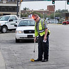 Enid police training officer, Casey Von Schriltz,  watches as rookie officer Tom Rhyne gathers information for an accident report September 24 in downtown Enid. (Staff Photo by BILLY HEFTON)