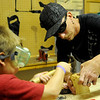 Nicholas and Kenneth DeVoll (from left) build a carpenter project together during Leonardo's Family Fun Festival Sunday at Leonardo's Discovery Warehouse and Adventure Quest. The event was free to the public as part of the Cherokee Strip Celebration festivities in Enid. (Staff Photo by BONNIE VCULEK)