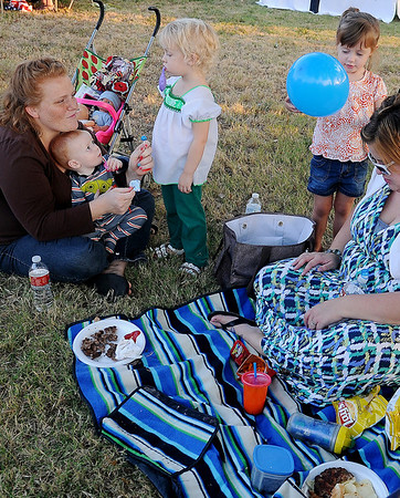 Families relax on the Garfield County Courthouse lawn Thursday as they enjoy the United Way fundraising kickoff. More than $228,000 of the $700,000 goal has already been raised through donations by Enid businesses and community members. (Staff Photo by BONNIE VCULEK)