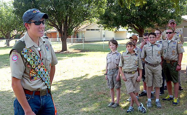 Jeremy Crise thanks the members of Troop 15 and other volunteers who helped construct a dog park on Vance Air Force Base for his eagle scout project during a dedication ceremony Wednesday. (Staff Photo by BILLY HEFTON)