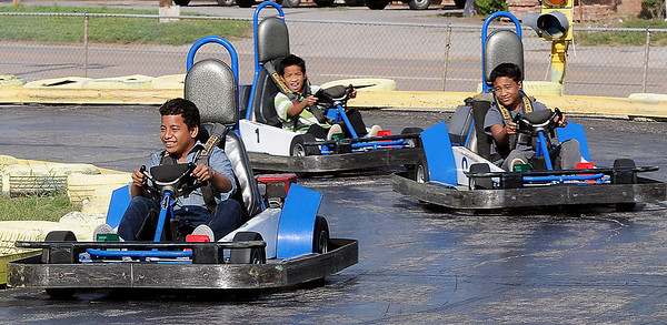 Witten Isaiah, Moses Isaiah and Daniel Meloktakon (from left) enjoy a few laps at Comet Go Carts, 3200 N. 4th, Sunday. (Staff Photo by BONNIE VCULEK)