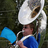 Reflections of the Enid High School homecoming pep rally appear in one of the EHS Big Blue Band's tubas Friday at D. Bruce Selby Stadium before the Plainsmen's game against the Tulsa Washington Hornets. (Staff Photo by BONNIE VCULEK)