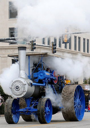 "H.E. Cummins ""Baker"" steam-powered engine rolls west on Randolph during the Cherokee Strip Celebration parade Saturday. (Staff Photo by BONNIE VCULEK)"