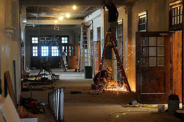 Construction workers continue the renovation of the third floor of Enid High School. (Staff Photo by BILLY HEFTON)