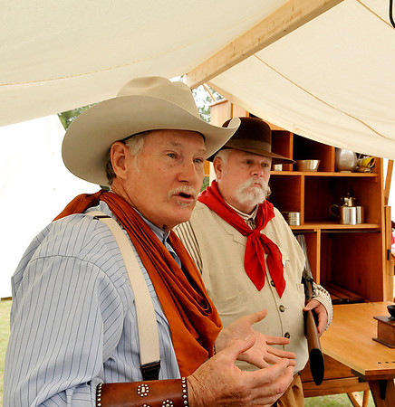 Lynn Shackelford and Mike Sheriff talk about the life of a cowboy on the Chisholm Trail Saturday during the Frontier Festival at the Cherokee Strip Heritage Center. (Staff Photo by BILLY HEFTON)