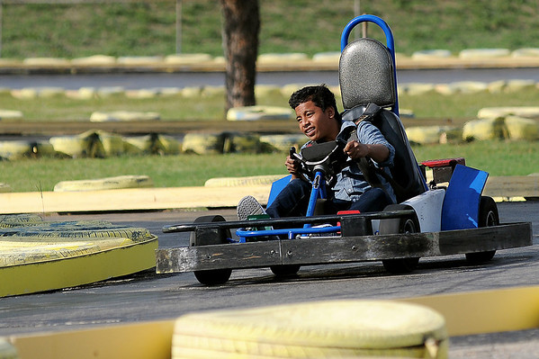 """Witten Isaiah negotiates an """"S"""" curve at Comet Go Carts Sunday. (Staff Photo by BONNIE VCULEK)"""