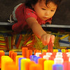 Zoelyn Morris, daughter of Aaron and Tonya Morris, tinkers with light pegs during Leonardo's Family Fun Festival. A land run and deed claim at Adventure Quest and activities inside Leonardo's Discovery Warehouse were free to the public Sunday as part of the Cherokee Strip Celebration festivities. (Staff Photo by BONNIE VCULEK)