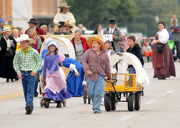 Students from St. Paul's Lutheran Church School display their Cherokee Strip Days spirit during the annual parade Saturday in downtown Enid. (Staff Photo by BONNIE VCULEK)