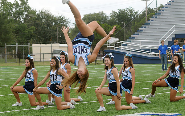 Enid High School cheerleaders enjoy the homecoming pep rally festivities as they complete a cheer Friday at D. Bruce Selby Stadium. (Staff Photo by BONNIE VCULEK)