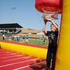 Brendon Tubbs scores during a football game at 4RKids Walk/Run festivities at David Allen Memorial Ballpark Saturday. The annual event raised more than $61,000. (Staff Photo by BONNIE VCULEK)