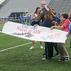 Members of Jamie Rhodd's special education class celebrate as EHS assistant principal Adam Beauchamp announces their banner as the winning homecoming design Friday during a school-wide pep rally at D. Bruce Selby Stadium. (Staff Photo by BONNIE VCULEK)
