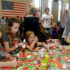 Children complete a craft project during the annual March of Dimes Breakfast with Santa Saturday at Enid High School. (Staff Photo by BONNIE VCULEK)