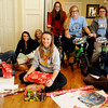 Enid High School Pacers basketball team wrap Christmas gifts for their adopted family Friday at 1205 York. New bicycles, toys and clothing will be delivered to the two young boys and their older sister Saturday morning. (Staff Photo by BONNIE VCULEK)